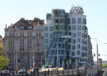 Building made out of two parts. One made out of glass one out of stone. One represents a man, one a woman. The Dancing House was based of a photograph of Fred Astair and Ginger Rogers dancing together. It was finished in 1996 and officially known as the Nationale Nederlanden Building. The Dancing House is standing on the Rasinovo river bank on the right side of the Vltava river. This deconstructivist building amazes people that walk the Prague...